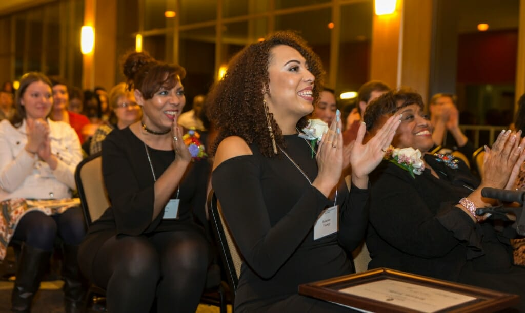 Honorees Posse Scholar Brianna Young, the first undergraduate to become an honoree, and Barbara Nichols, right, the and advocate of diversity in nursing, applaud their peers.