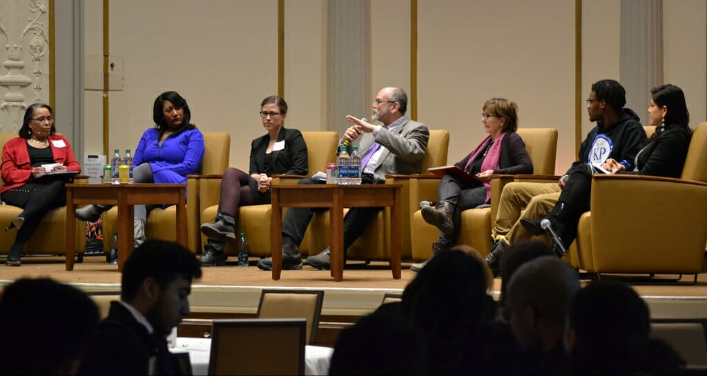 Photo: Luis Pinero speaking as part of panel of guests