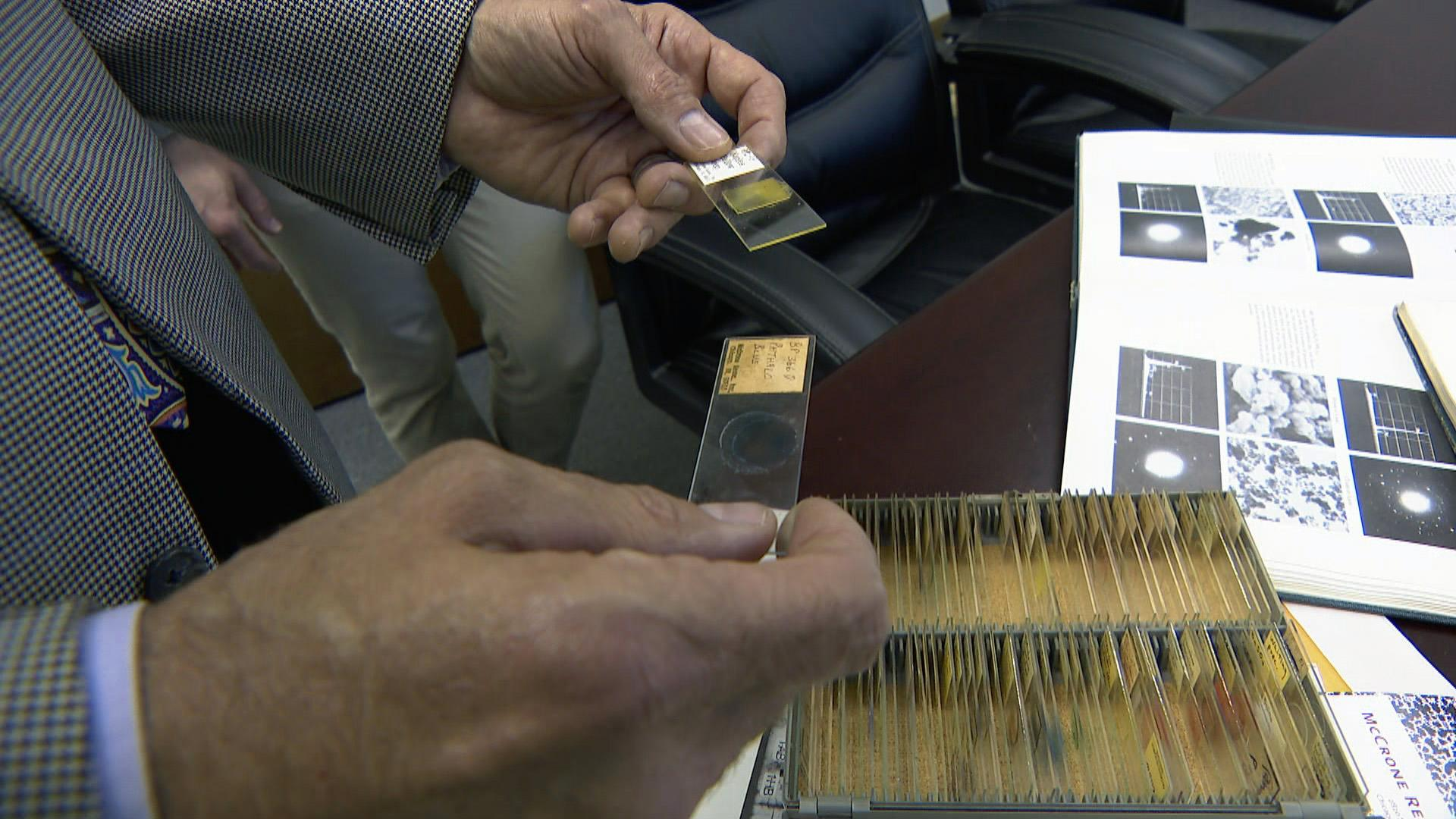 Gary Laughlin handles specimens at theMcCrone Research Institutein Bronzeville, founded in 1960 by Walter McCrone. (WTTW News)