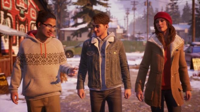 Michael Abila walking with Tyler and Alyson Ronan.