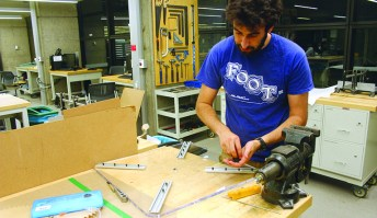 Brian Beitler constructs the Ontrack device.