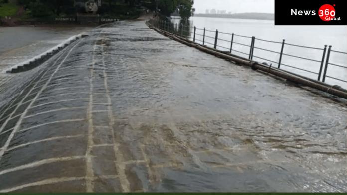 car swept away in mumbai, lake