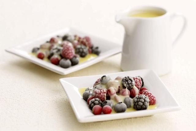 Iced berries with white chocolate sauce