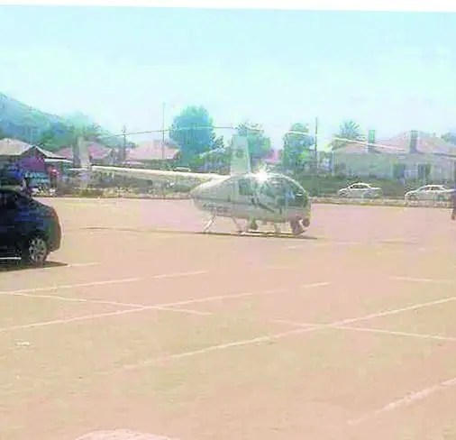 Police Officer Lands Chopper to buy Chicken