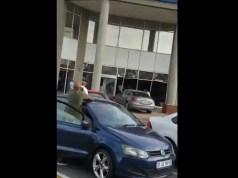 Woman drives car into Bank