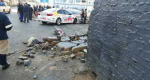 One dead another injured in wall collapse