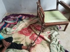 child_tied_to_chair