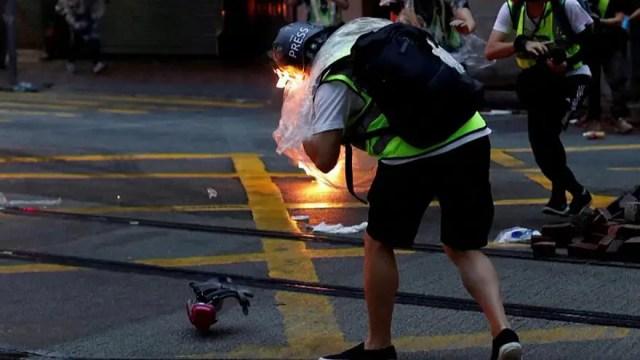 Journalist hit by petrol bomb