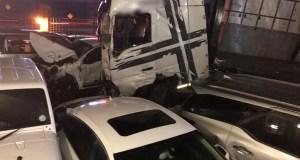 Truck crashes through car park