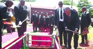 Irvin Khoza paid his lastrespect by pouring soil over his wife Mantwa's grave