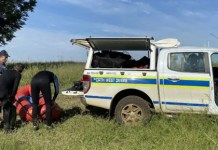 Police divers during the search for Parktown Boys' High School learner Enoch Mpianzi