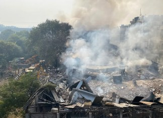 Twelve people, mainly firefighters, suffered injuries and one remained trapped inside the battery factory