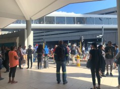 Metrorail commuters are standing outside the Cape Town train station