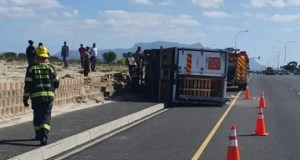 Delivery truck overturns