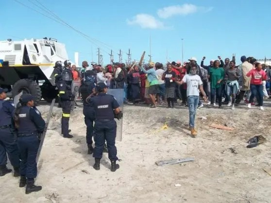 Law enforcement and protesters confront each other in Khayelitsha