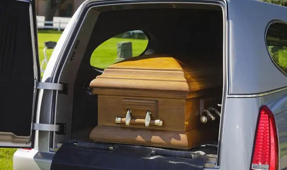 Hearse carrying coffin