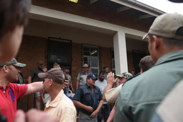 police and farmers clash outside farm murder court case