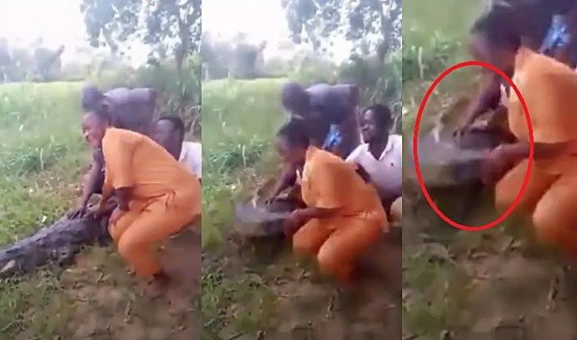 Woman bitten by crocodile while trying to take a photo