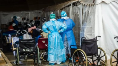 Health care workers and patients in the temporary outside area Steve Biko Academic Hospital created to screen and treat suspected Covid-19 cases in Pretoria
