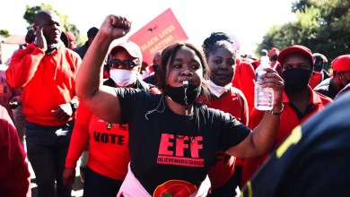 EFF members rally outside Uitsig High School as they wait for Julius Malema