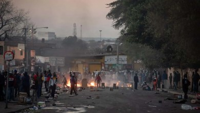 Rioting looters can be seen in Alexandria township in Johannesburg