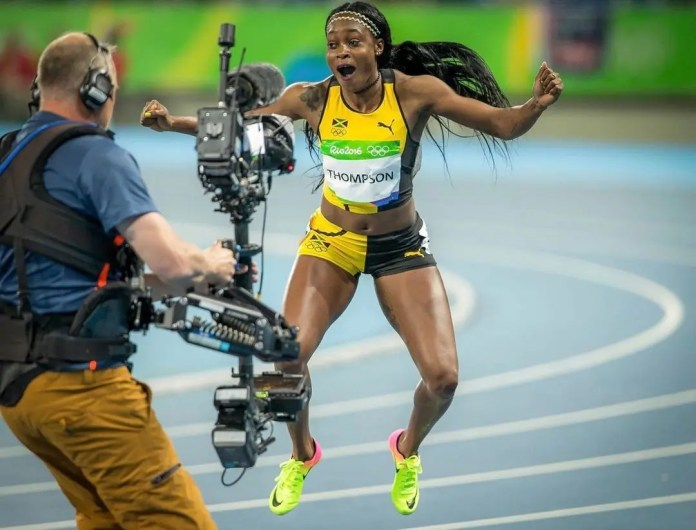 Jamaican sprinter Elaine Thompson-Herah smashes Olympic record to win 100m gold