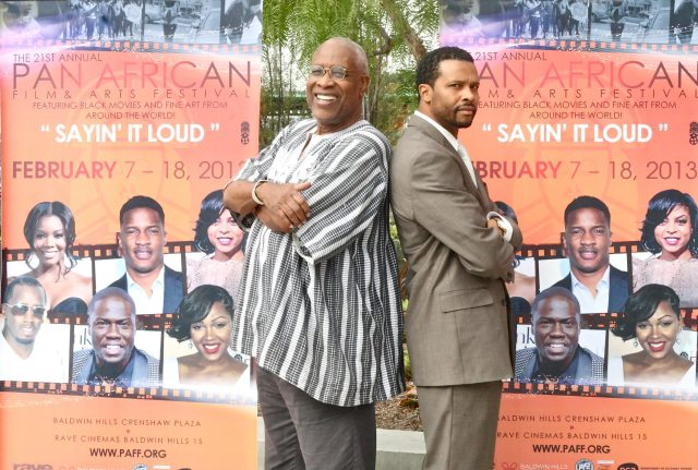 Holla II writer and director, HM Coakley stands tall next to Pan African American Film Festival founder and executive director Ayuko Babu.