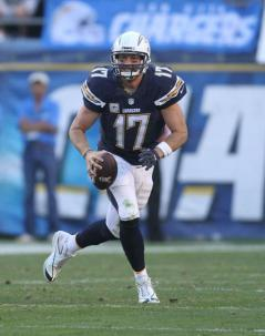 Philip Rivers, on the move here against the Denver Broncos, is hoping to lead the Chargers into the playoffs. Photo Credit: Kevin Reece/News4usonline.com