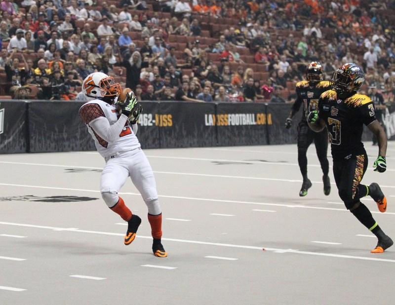 Shock receiver Brandon Thompkins (2) gets behind Kiss Defender Andre Jones (3) for a Touchdown. Photo Credit: Jordon Kelly / News4usonline.com