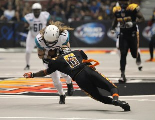 Romeo Pellum Kiss Defensive back coming up to stop Rattlers Tysson Poots. Photo Credit: Jordon Kelly / News4usonline.com
