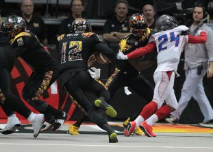 New Spark Option Quarterback Kenny Guiton (12) gaining few yards. Photo Credit: Jevone Moore /News4usonline.com