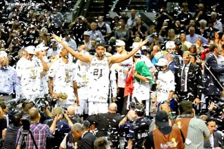 Tim Duncan and the San Antonio Spurs celebrate winning the 2014 NBA title over the Miami Heat. Photo Credit: Antonio Uzeta/News4usonline.com