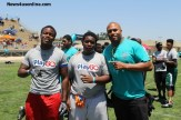 Former NFL linebacker and Long Beach Poly High School football coach Antonio Pierce with a couple of campers. Photo Credit: Dennis J. Freeman/News4usonline.com