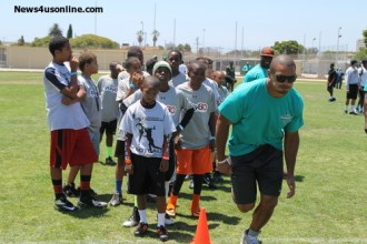 Jacksonville Jaguars tight end Clay Harbor goes over some drills with a few youngsters at the 6th Annual Marcedes Lewis Football Camp at Long Beach Poly High School in Long Beach, California. Photo Credit: Dennis J. Freeman/News4usonline.com