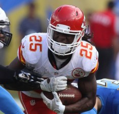 Jamaal Charles on his way to some hard-earned yards against the san Diego Chargers in a 2014 AFC West matchup at Qualcomm Stadium in San Diego. Photo Credit: Kevin Reece/News4usonline.com