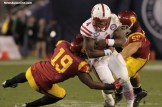 Nebraska quarterback Tommie Armstrong Jr. bulls his way for yardage against the Trojans. Photo Credit: Jevone Moore/News4usonline.com