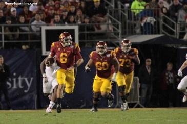 Cody Kessler (6) escapes the pocket and heads down field for good yardage against Nebraska in the National University Holiday Bowl. Jevone Moore/News4usonline.com