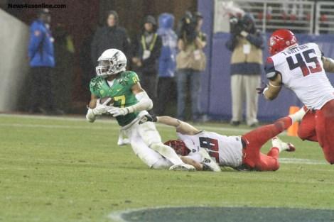 Oregon didn't let up against Arizona, despite a driving rainstorm. Photo Credit: Jevone Moore/News4usonline.com
