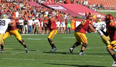USC quarterback Cody Kessler drops back to throw one of his six touchdowns against Notre Dame in the Trojans' final home game of the season. Photo Credit: Dennis J. Freeman/News4usonline.com