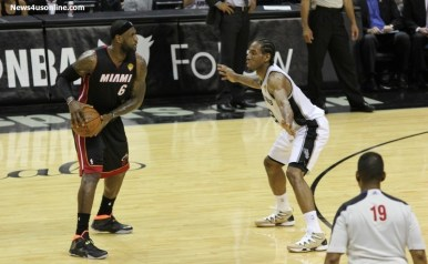 2014 NBA Finals MVP Kawhi Leonard of the San Antonio Spurs tries to stop LeBron James from making a pass. Photo Credit: Antonio Uzeta/News4usonline.com