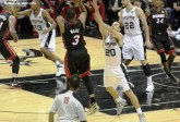 Miami Heat's Dwayne Wade shoots over the outstretched hand of Manu Ginobili in Game 5 of the 2014 NBA Finals. Photo Credit: Antonio Uzeta/News4usonline.com
