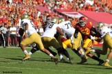 USC defenders get after Notre Dame quarterback Everett Golson in the Trojans' season finale at the Los Angeles Memorial Coliseum. Photo Credit: Dennis J. Freeman/News4usonline.com