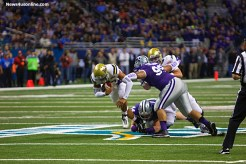 UCLA quarterback Brett Hundley bolws his way over several Kansas State defenders during the 2015 Valero Alamo Bowl in San Antonio,Texas. Photo by Antonio Uzeta/News4usonline.com