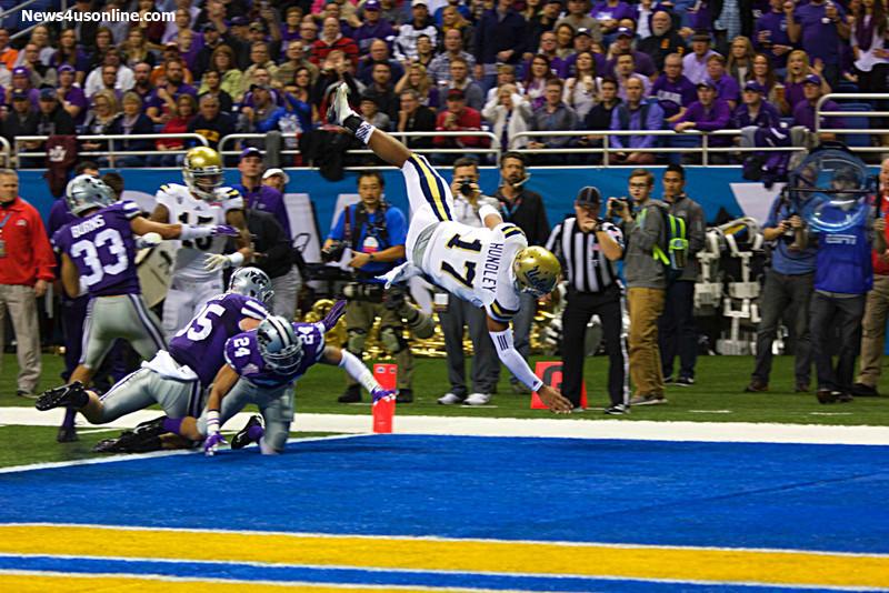UCLA quarterback Brett Hundley gets upended as he scores a touchdown. Photo by Antonio Uzeta/News4usonline.com