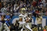UCLA quarterback Brett Hundley celebrates after scoring a touchdown. Photo by Antonio Uzeta/News4usonline.com