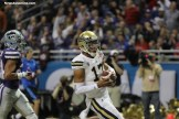 UCLA quarterback Brett Hundley celebrates after scoring a touchdown. Photo by Antonio Uzeta/News4usonline.com