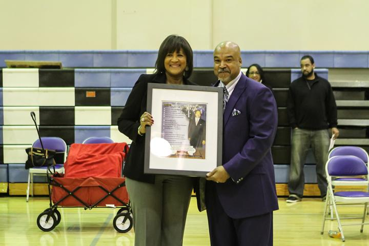 Price head basketball coach Michael Lynch receives recognition on securing his 500th career win. Photo by Jevone Moore/Courtesy ofFull Image 360
