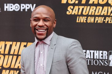 Floyd Mayweather Jr. is all smiles during the press conference announcing his fight with Manny Pacquiao. Photo Credit: Jevone Moore/News4usonline.com