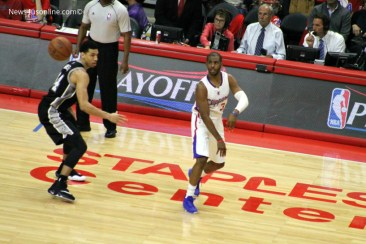 Chris Paul makes a pass in Game 2 of the 2015 NBA playoffs against Danny Green and the San Antonio Spurs at Staples Center. Photo Credit: Dennis J. Freeman/News4usonline.com