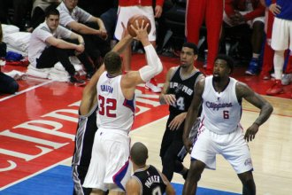 Blake Griffin powers up for another highlight-reel play against Tim Duncan and the San Antonio Spurs in Game 2. Photo Credit: Dennis J. Freeman/News4usonline.com